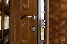 new steel three bolt door lock installed on the wooden front