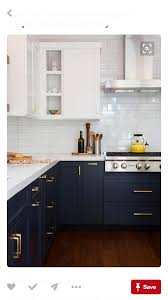 white cabinets on top blue on bottom navy cabinets on bottom and white cabinets up top with