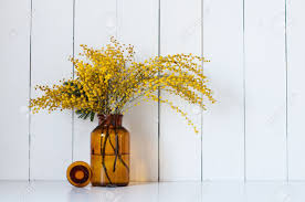 home decor photography home decor mimosa yellow spring flowers in a vintage bottle