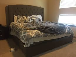 gerlane king upholstered bed in brown beige nebraska furniture mart