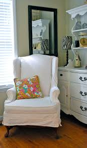 white slipcover chair white wing back chairs thedailyqshow