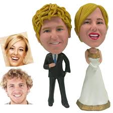 hand crafted personalized wedding cake topper of a golden couple
