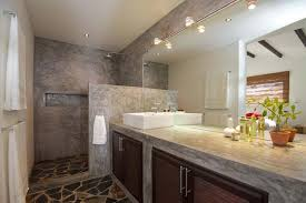 stone wall bathroom design brown chair white tile white granite