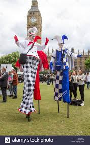 clown stilts london uk 13th july 2016 three colourful clowns on stilts stock