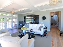 traditional living room with box ceiling by jps construction and