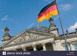 The Germany Flag The German Flag Flying In Front Of The Reichstag In Berlin The