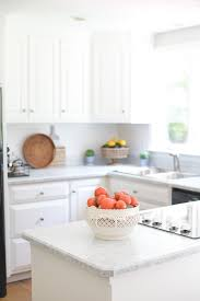 how to remove sticky residue kitchen cabinets how i painted my kitchen countertops andie mitchell