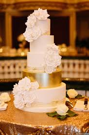 5 tier wedding cake 5 tier wedding cake with white sugar roses and painted gold