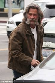 best hair cut for 64 year old with round a face kurt russell sports a new haircut while cruising around town with