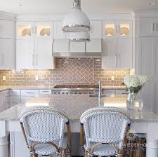 white and gray kitchen design with gray glass subway tile and