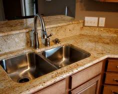colonial cream granite kitchen with cherry cabinets and tile
