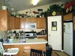 ideas for on top of kitchen cabinets top kitchen cabinet decorating ideas decorating the top