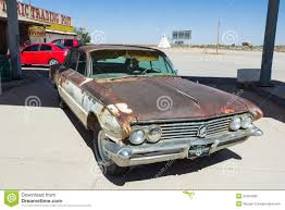 rusty car rusty car with skeleton editorial photo image of desert 34554006