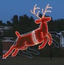 santa sleigh and reindeer light sculpture display lit with