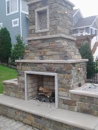outdoor fireplace with edwards natural stone and limestone trim