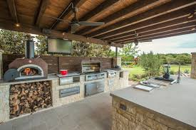 outdoor stone outdoor kitchen island with pull down faucet also