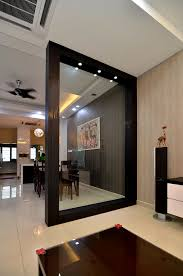wooden partition with glass to separate dining place from living