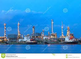 Beautiful Lighting Oil Tanker Ship On Port Against Beautiful Lighting In Dusky Sky
