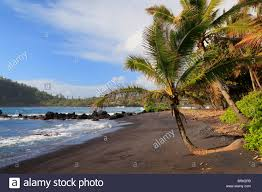 Black Sand Beaches by Black Sand Beach In Hana Bay On The Northeast Coast Of Maui In