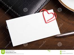 heart shaped writing paper empty business card and heart shaped paper clip stock photo royalty free stock photo