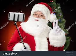 happy santa claus taking selfie peace stock photo 567519607