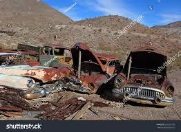 car yard junkyard old rusted car junk yard national stock photo 226355728 shutterstock