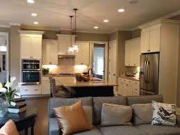 dream open concept kitchen with white or cream cabinets and an