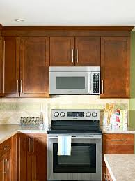 microwave in kitchen cabinet how to integrate a microwave better homes gardens