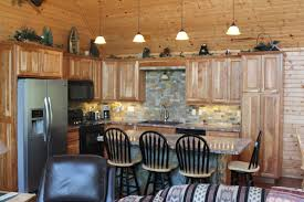 rustic pine kitchen cabinets indoor three blackbarstools in classic kitchen design together