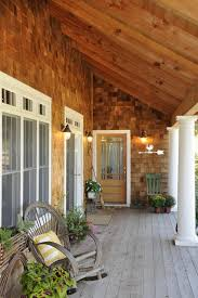 covered porch with cedar shakes rustic entry other by jg