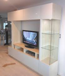 Laminated Wooden Floor Delightful Home Design With White Entertainment Center And