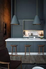 appliances cone gray pendant light white granite countertop