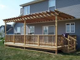 composite backyard deck with pergola and lattice adding a