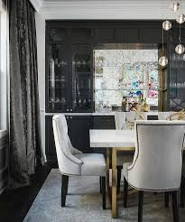 gray dining room with full wall of built in glass front bar