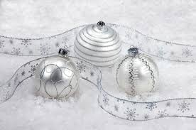 three white and silver ornaments on snow stock image