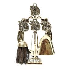 equine brass fireplace tools set on the highboy