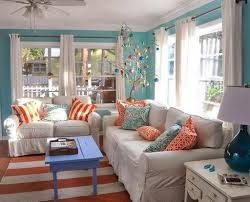 themed living room ideas orange and teal toss pillows for classic themed living room