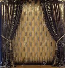 luxurious old fashioned designer window curtains in gold stock