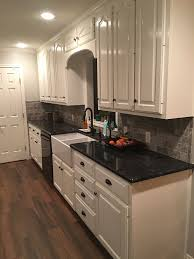 white cabinets with black countertops and appliances black stainless steel appliances steel gray counter tops