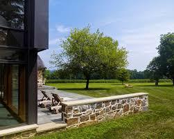 design wide green grass yard near farmhouse addition near stone