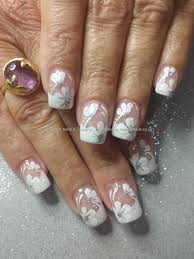 white acrylic tips with one stroke flower nail art fingers and