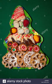 christmas tree tray holding an arrangement of fancy decorated