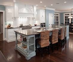lovely traditional kitchen with small island feat breakfast bar
