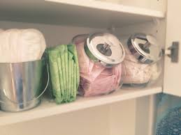 organizing your apartment looking for a way to organize your lady items use a cookie jar to