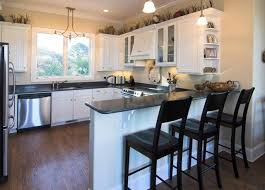 g shaped kitchen layout ideas g shaped kitchen with island large refrigerator mix four stove gas