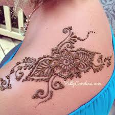 swirly henna tattoo on the shoulder by kelly caroline michigan