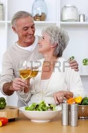 les amoureux de la cuisine attractive preparing salad in the kitchen with fresh