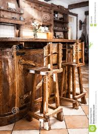 two high wooden bar chairs in country style royalty free stock