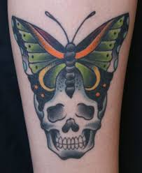 traditional skull with butterfly ink