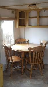 solid wood extenbel table and 6 wooden chairs in welshpool